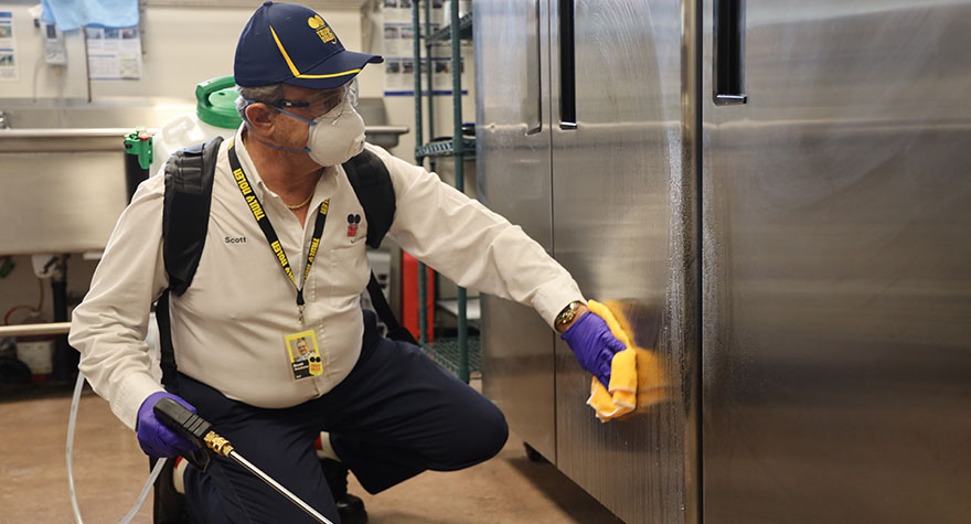 Wiping Industrial Refrigerator with Sanitizing Wipe