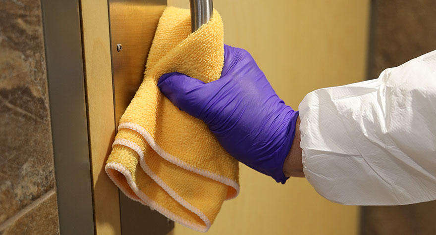 Wiping Door Handle with Sanitizing Wipes